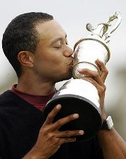 Tiger Woods lifts the Claret Jug at St Andrews Open 2005
